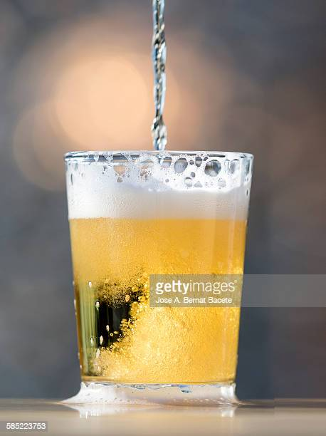 Beer being poured into glass, close-up
