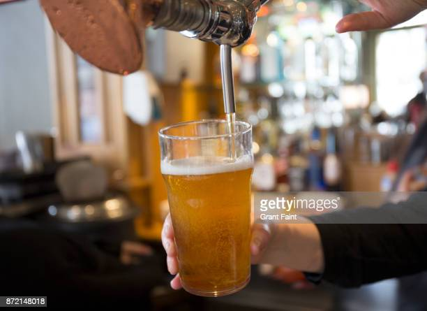 beer being served in sydney pub. - pub stock pictures, royalty-free photos & images