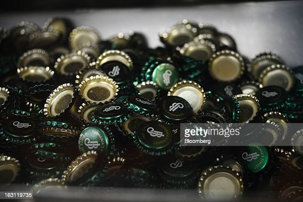 Beer bottle caps are loaded into a tray at the Boag's brewery operated by Kirin Holdings Co's Lion unit in Launceston Tasmania Australia on Monday...