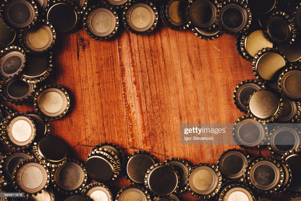 Beer Bottle Caps Frame Over Wooden Background Stock Photo   Getty Images