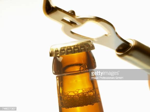 Beer bottle neck with crown cap and bottle opener