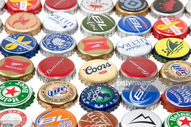 beer bottle tops - bud light stock pictures, royalty-free photos & images