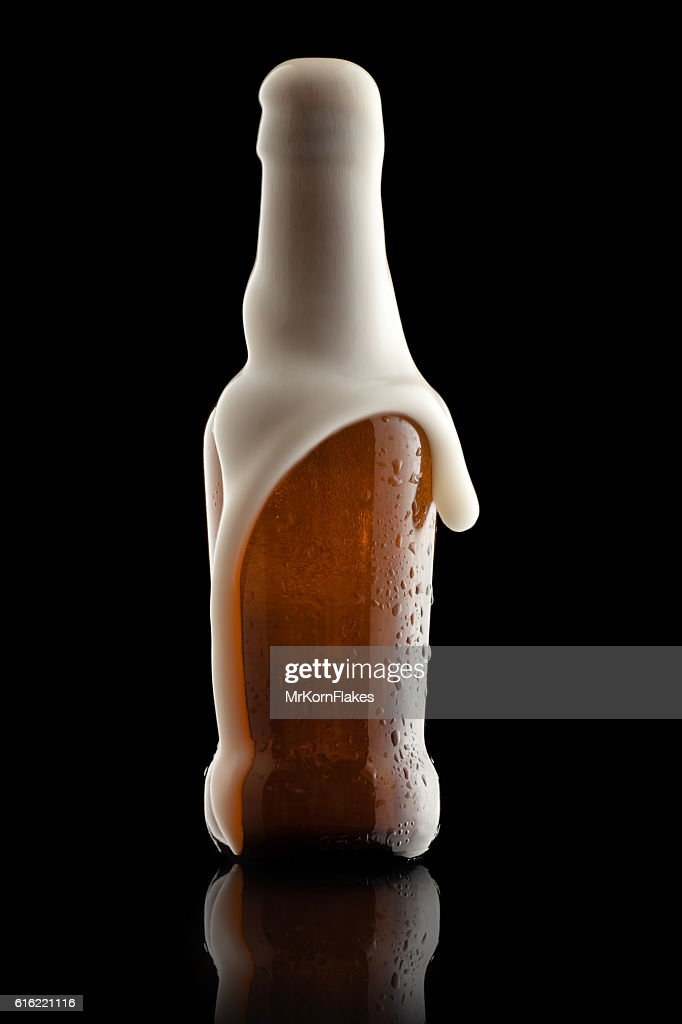 Beer Bottle with Suds : Stock Photo