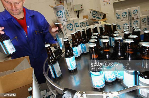 Beer bottles come off a line at the Scottish microbrewery Brew Dog on September 1 2010 in Fraserburgh Scotland Founded three years ago by James Watt...