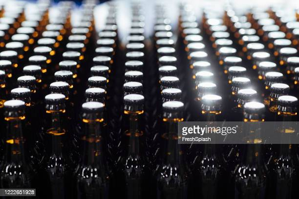 beer bottles in close up - ale stock pictures, royalty-free photos & images