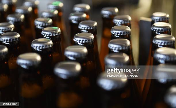 Beer bottles of Belgian microbrewery 'Brasserie de la Senne' are seen on an assembly line at the brewery in Brussels on October 23 2015 To understand...