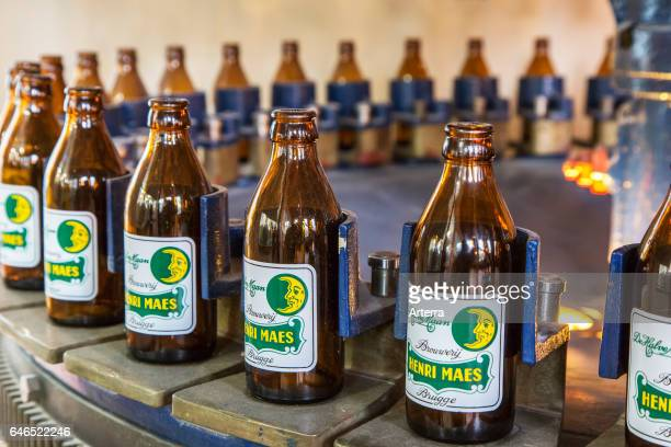 Beer bottles on the assembly line of Brouwerij Henri Maes Belgian brewery at Bruges Belgium