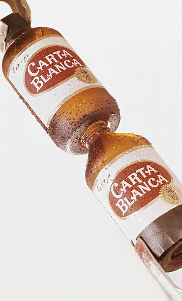 Beer bottles on white background, close-up