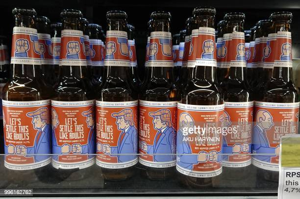Beer bottles with labels depicting Russian President Vladimir Putin and US President Donald Trump and bearing the slogan Let's Settle this like...