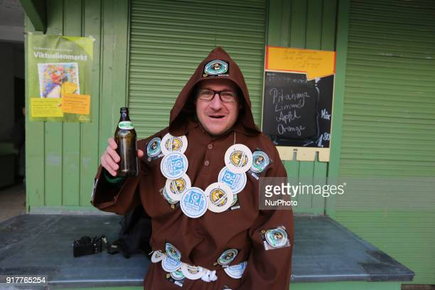 A beer brewing monk is seen in the Munich Carnival in Munich Germany on 13 February 2018
