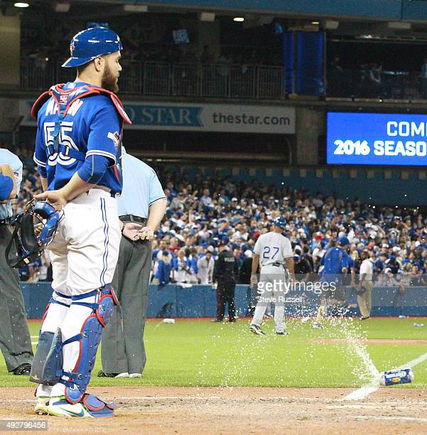 A beer can falls near Russell Martin as Toronto Blue Jays manager John Gibbons disputes a call made on the field by the umpiring crew that allowed...