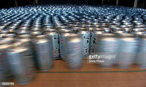 Beer cans are seen on the production line in Guangzhou Zhujiang Beer Group Company factory on August 6 2005 in Guangzhou of Guangdong Province South...
