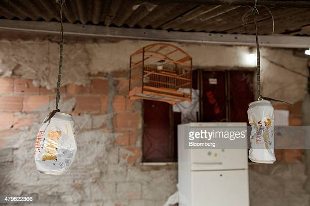 Beer cans hang from the ceiling of a bar in the Dilma Rousseff favela of Rio de Janeiro Brazil on Monday July 6 2015 As the fastest inflation in more...