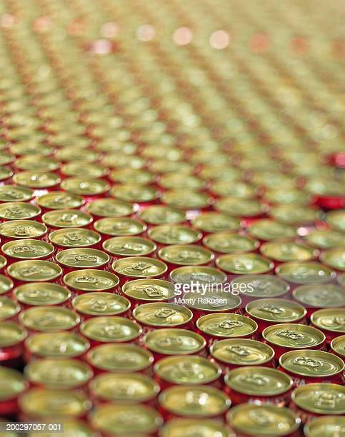 Beer cans in brewery production line, close-up