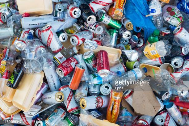 Beer cans polystyrene cartons plastic bottles plastic bags and other rubbish lies in a pile on a street in west London