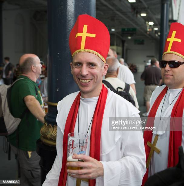A beer drinker dressed as a priest enjoying the Great British Beer Festival at Olympia London where Prince Harry made an unofficial visit yesterday