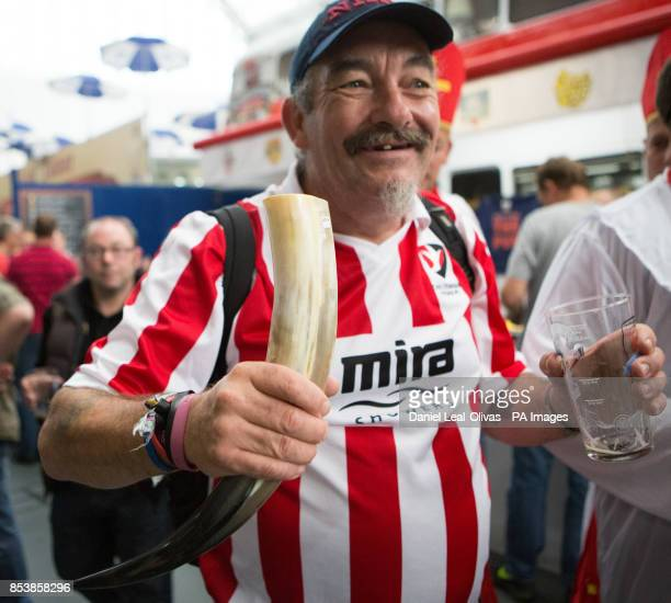 A Beer drinker with a 'Viking beer horn' enjoying the Great British Beer Festival at Olympia London where Prince Harry made an unofficial visit...