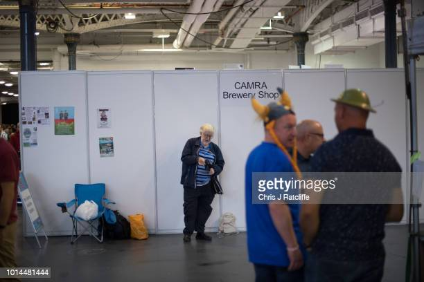 A beer enthusiast folds up his stool during the Great British Beer Festival at Olympia Exhibition Centre on August 10 2018 in London England The five...