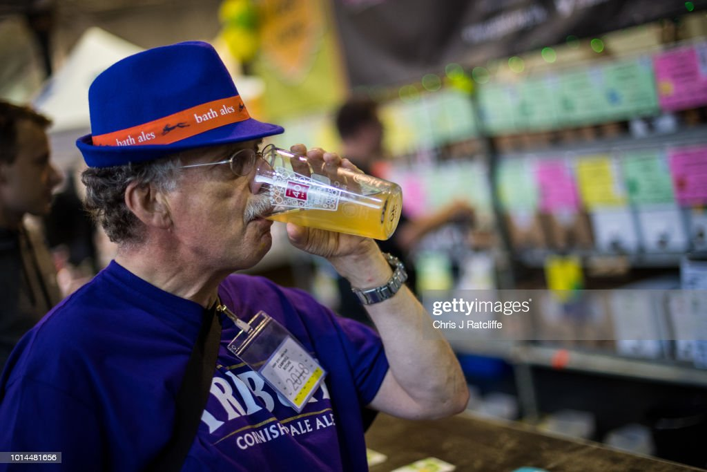 A beer enthusiast tries a beer during the Great British Beer Festival at Olympia Exhibition Centre on August 10, 2018 in London, England. The five day festival showcases over 900 real ales and craft beer and is organised by Campaign for Real Ale group CAMRA.