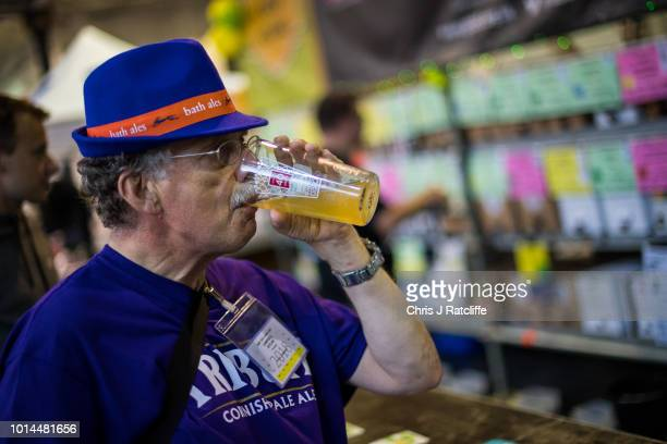 A beer enthusiast tries a beer during the Great British Beer Festival at Olympia Exhibition Centre on August 10 2018 in London England The five day...