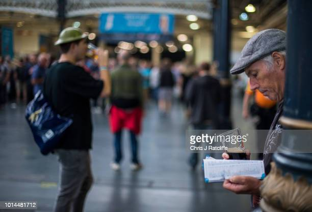 A beer enthusiast tries a beer whilst reading the show guide during the Great British Beer Festival at Olympia Exhibition Centre on August 10 2018 in...