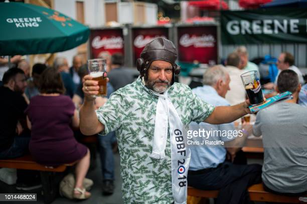 A beer enthusiast walks from the bar during the Great British Beer Festival at Olympia Exhibition Centre on August 10 2018 in London England The five...