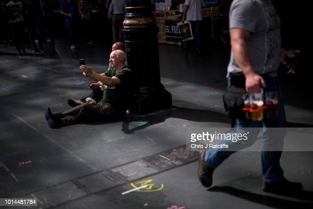Beer enthusiasts take a selfie during the Great British Beer Festival at Olympia Exhibition Centre on August 10 2018 in London England The five day...