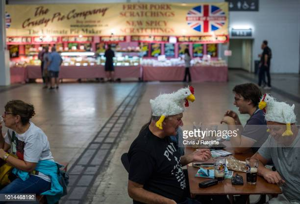 Beer enthusiasts talk whilst wearing costumes during the Great British Beer Festival at Olympia Exhibition Centre on August 10 2018 in London England...
