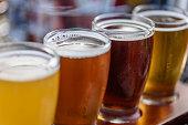 Beer flight in summer sunlight