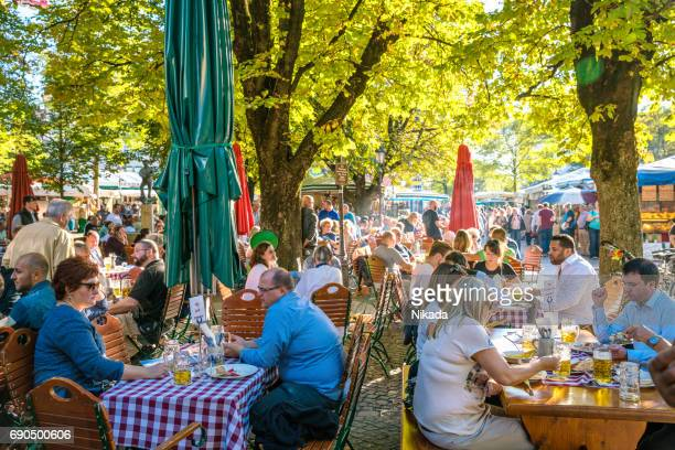 beer garden in munich, bavaria, germany - viktualienmarkt stock pictures, royalty-free photos & images