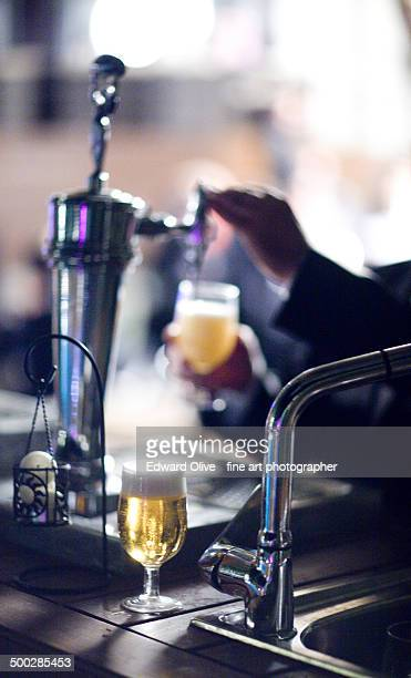 Beer glass on bar in upscale wedding party