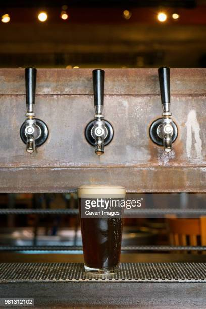 beer glass under taps - handle stock pictures, royalty-free photos & images