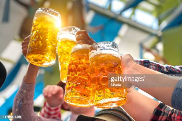 beer glasses in tent at octoberfest in munich - oktoberfest stock pictures, royalty-free photos & images