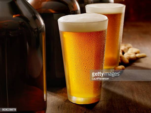 beer growlers - beer glass stock pictures, royalty-free photos & images