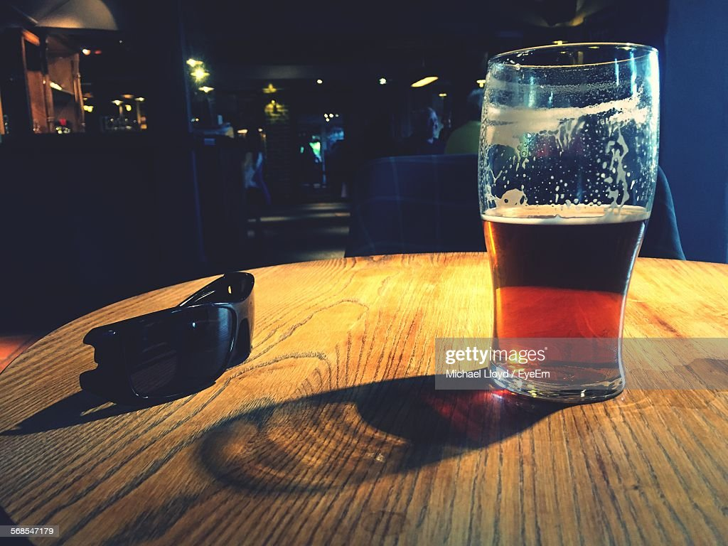 Beer In Glass By Sunglasses On Table : Stock Photo
