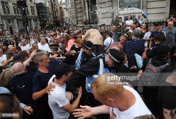 Beer is thrown as demonstrators clash with police during a 'Free Tommy Robinson' protest on Whitehall on June 9 2018 in London England Protesters are...