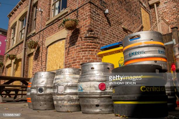 Beer kegs are seen outside a boarded-up public house in Leeds city centre, West Yorkshire on April 14 as life in Britain continues during the...