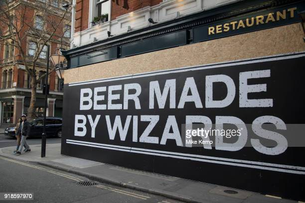 Beer made by wizards hoarding on a building under redevelopment in London England United Kingdom