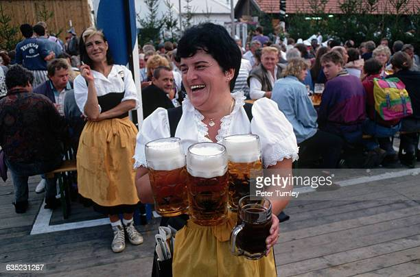 A beer maid holds three litres of fest bier at Oktoberfest