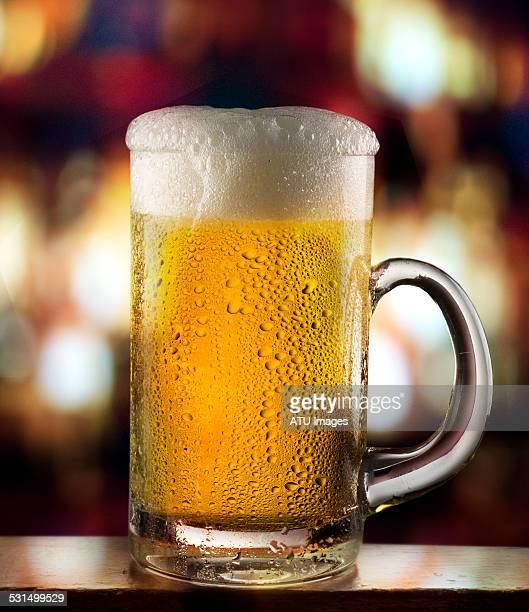 Beer mug on bar with lights