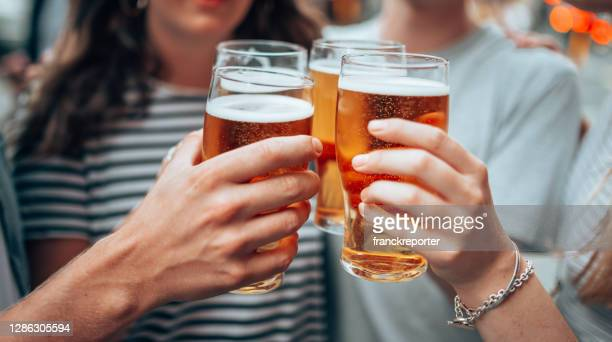 beer o'clock with friends - outdoors stock pictures, royalty-free photos & images