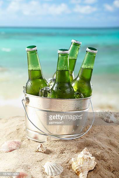 beer on the beach - bucket stock pictures, royalty-free photos & images