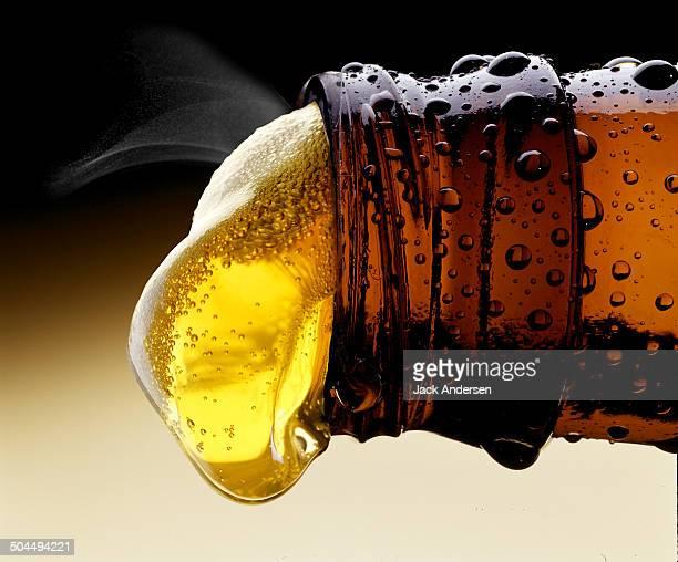 beer pouring from beer bottle - füllen stock-fotos und bilder