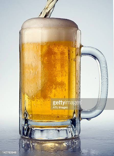 beer pouring into beer mug - beer stein stock photos and pictures
