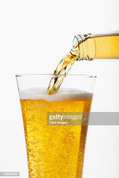 Beer pouring into glass, studio shot