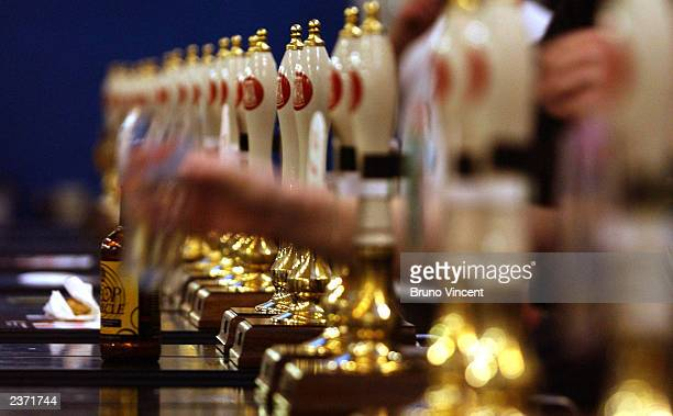 Beer pumps are seen at the Great British Beer Festival at the Olympia Exhibition Center August 5 2003 in London England