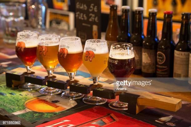 Beer sampler plank with Belgian beers for beer tasting in Flemish cafe