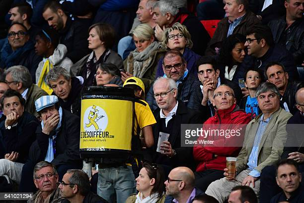 A beer seller passes amongst the crowd during the Rugby Top 14 League semi final match between Racing 92 and Clermont Auvergne at Roazhon Park on...