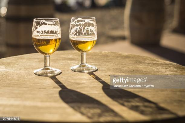 Beer Served In Wineglasses On Wooden Table