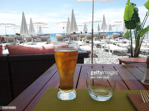Beer served on a table facing the seafront on the french Riviera in a beach bar in France